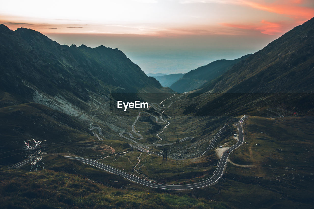 mountain, scenics - nature, sky, beauty in nature, environment, tranquil scene, tranquility, mountain range, cloud - sky, landscape, non-urban scene, nature, no people, sunset, idyllic, transportation, road, mountain road, outdoors