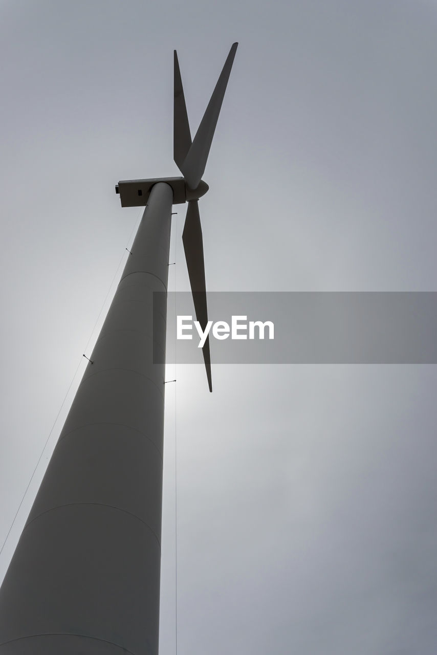 low angle view, sky, wind turbine, turbine, fuel and power generation, wind power, environmental conservation, renewable energy, no people, alternative energy, nature, environment, architecture, tall - high, day, outdoors, technology, built structure, copy space, building exterior