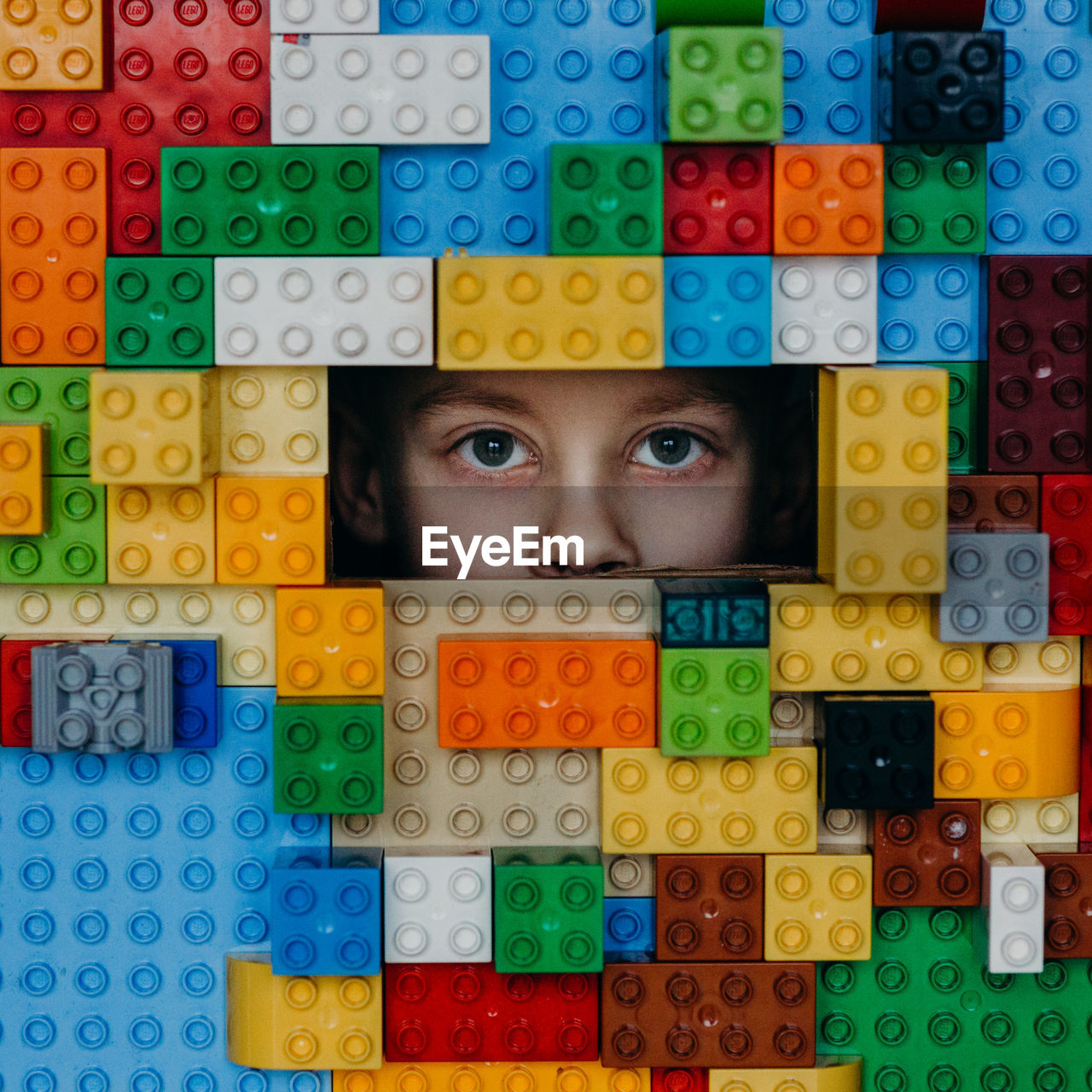 multi colored, looking at camera, human eye, portrait, large group of objects, colorful, toy block, arrangement, indoors, variation, human body part, puzzle, one person, close-up, eyeball, day, people