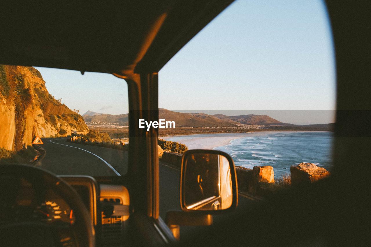 Sea Seen Through Bus Window