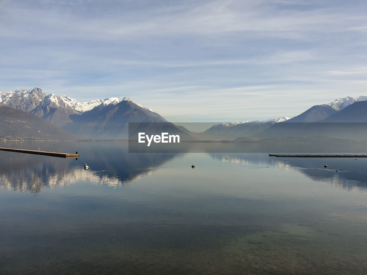 water, scenics - nature, beauty in nature, mountain, sky, tranquil scene, reflection, cold temperature, lake, tranquility, winter, cloud - sky, non-urban scene, waterfront, mountain range, idyllic, nature, snow, no people, snowcapped mountain, ice, reflection lake