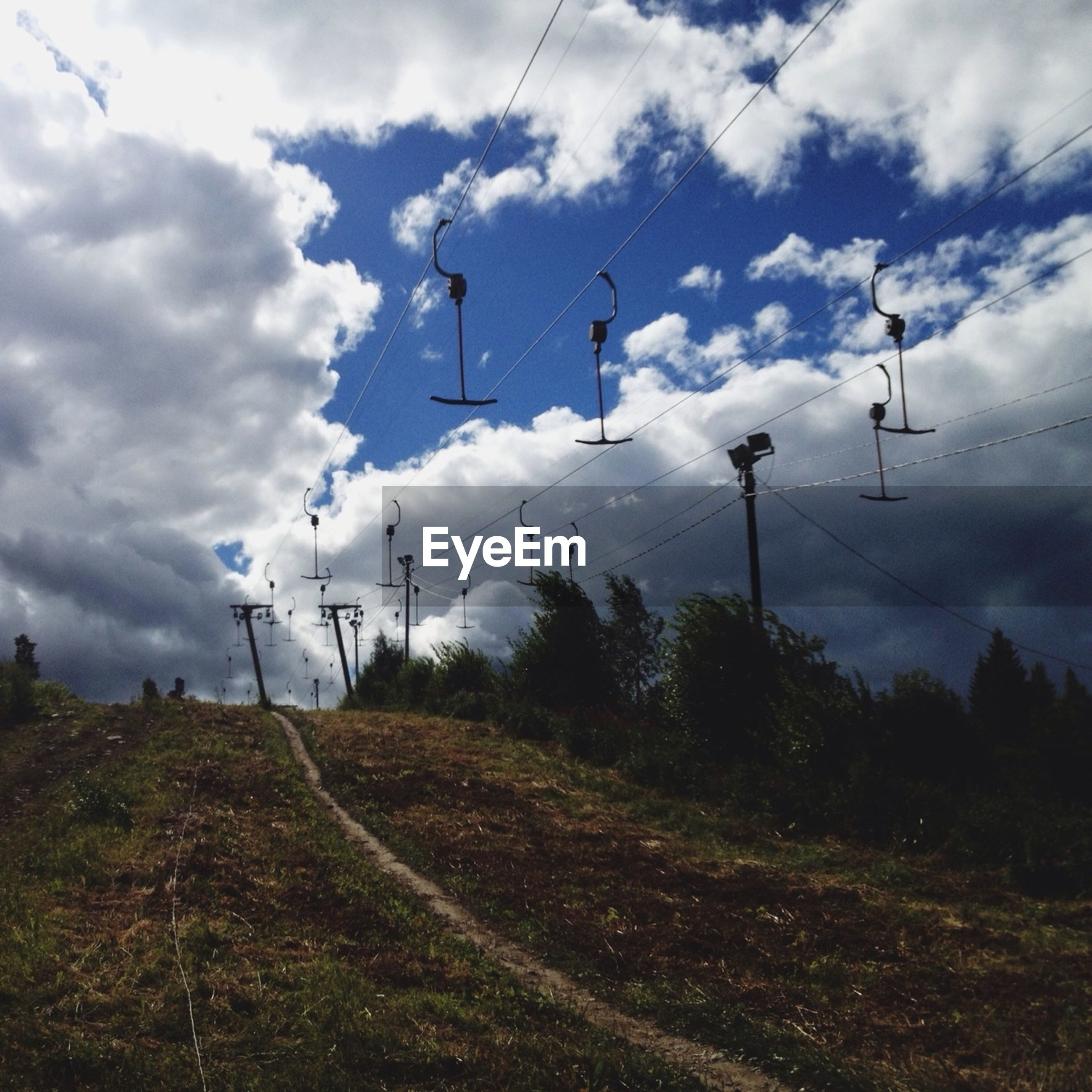 sky, cloud - sky, cloudy, power line, electricity pylon, electricity, fuel and power generation, cloud, landscape, field, transportation, power supply, technology, tranquility, connection, nature, cable, tranquil scene, day, low angle view