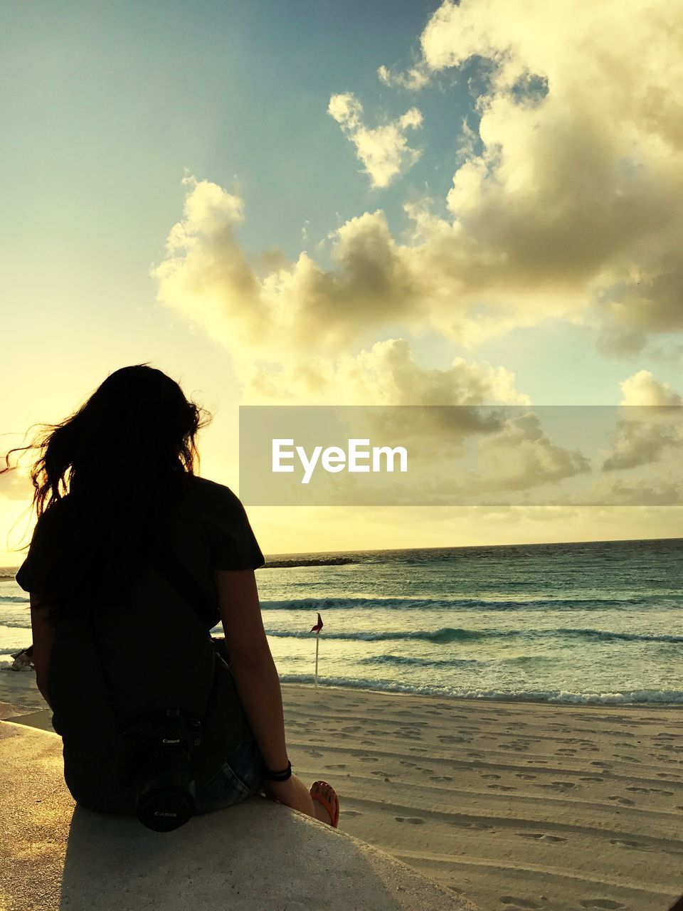 sea, one person, horizon over water, beach, sky, cloud - sky, water, real people, beauty in nature, sitting, nature, full length, sunset, rear view, women, tranquil scene, outdoors, leisure activity, relaxation, lifestyles, young women, day, young adult, one young woman only, adult, people