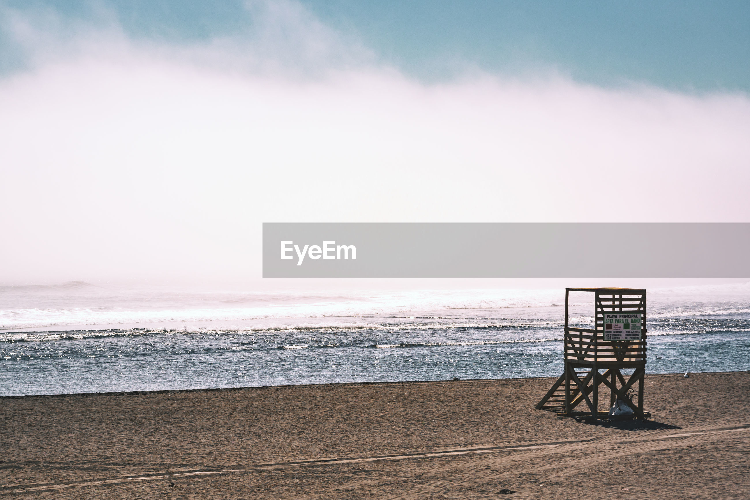 water, sky, sea, beach, land, horizon over water, scenics - nature, beauty in nature, horizon, nature, safety, tranquility, tranquil scene, no people, lifeguard hut, protection, outdoors, security, man made structure