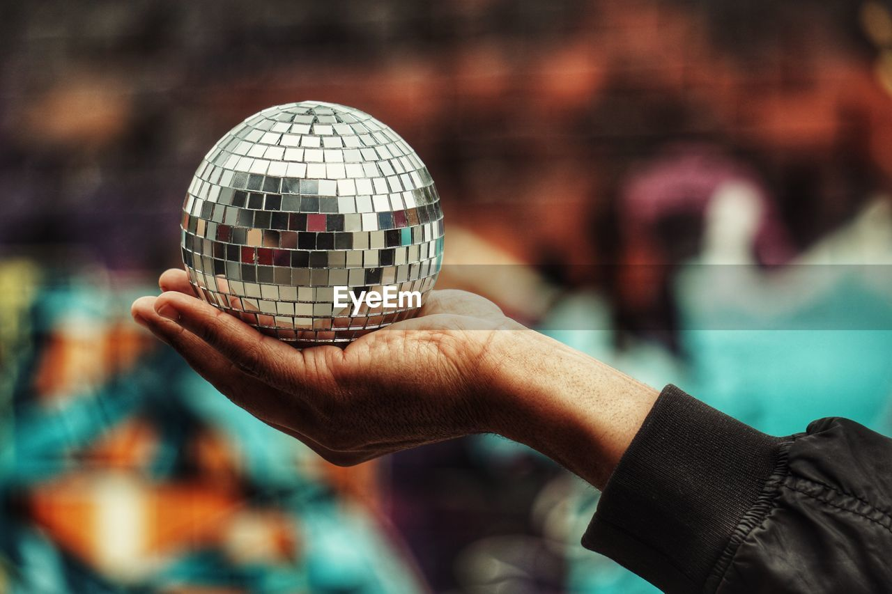 Cropped hand holding disco ball