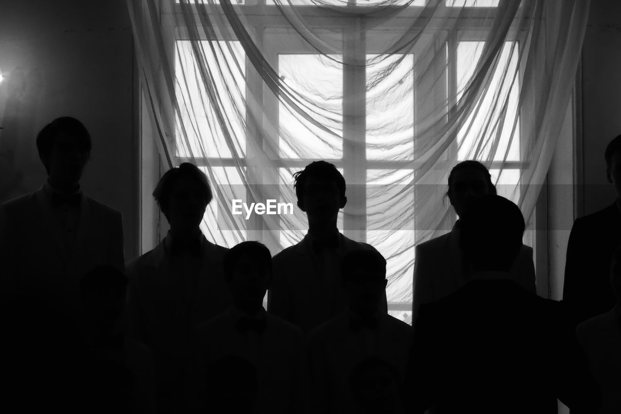 group of people, real people, curtain, men, indoors, window, lifestyles, women, people, togetherness, adult, sitting, silhouette, rear view, leisure activity, waist up, day, sunlight, standing