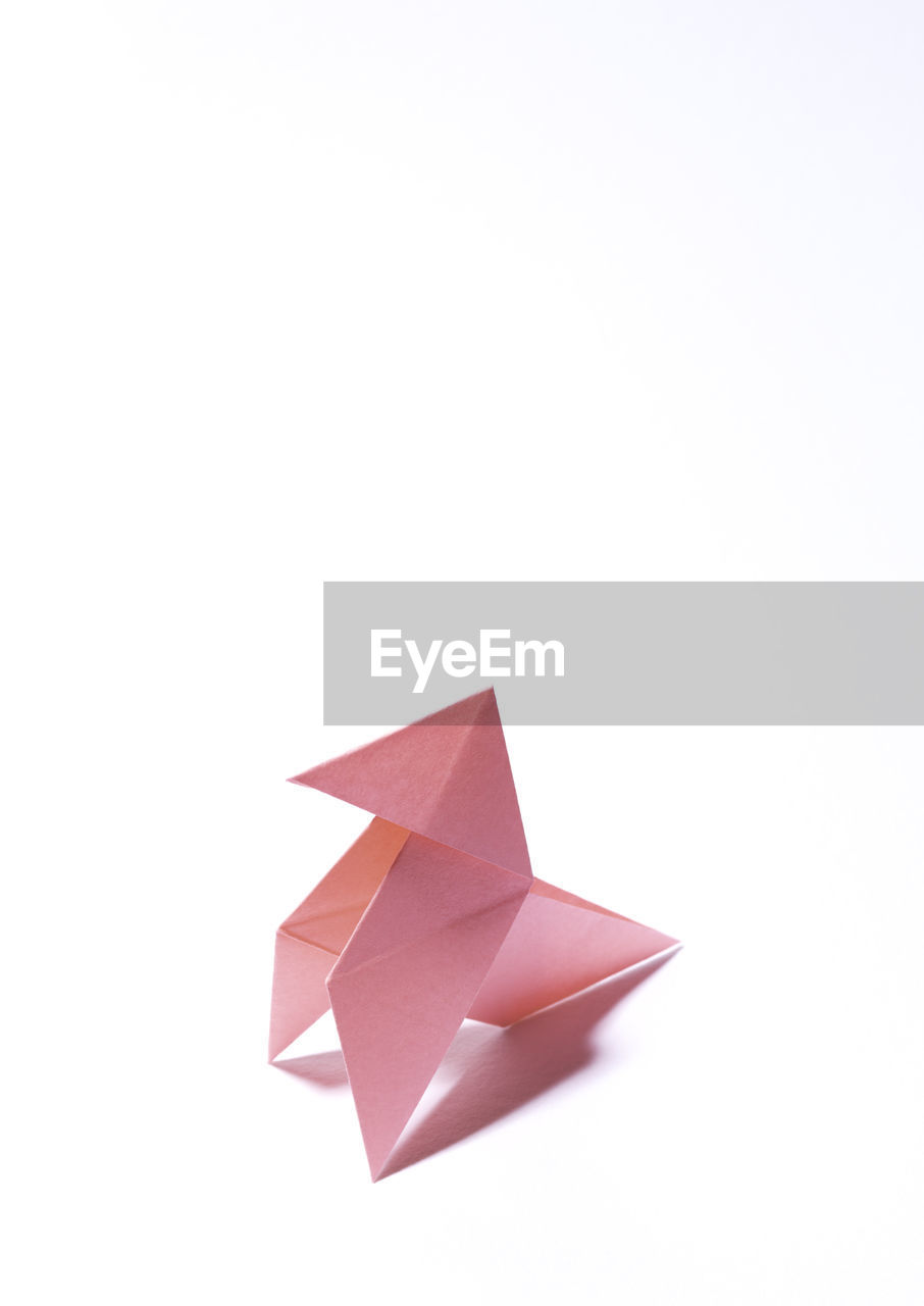 studio shot, white background, art and craft, copy space, creativity, craft, indoors, cut out, no people, paper, origami, still life, paper boat, close-up, toy, folded, design, pink color, shape, high angle view