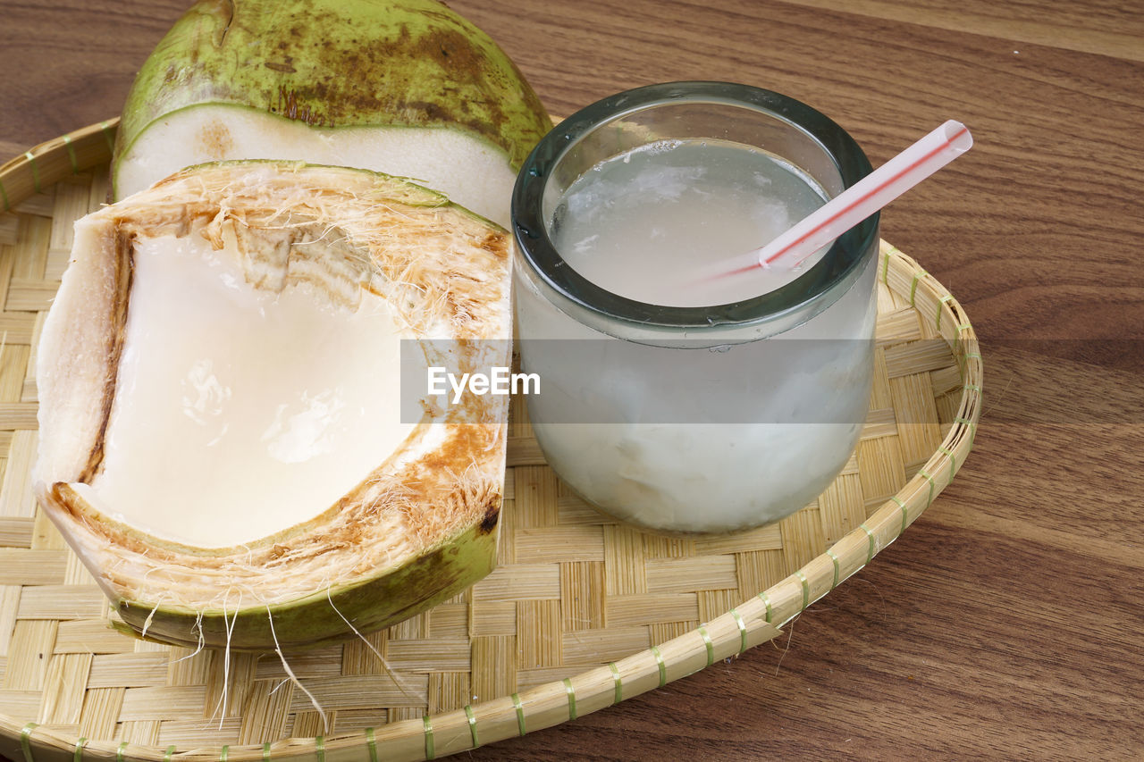 food and drink, food, table, freshness, still life, indoors, bread, ready-to-eat, high angle view, close-up, no people, wellbeing, healthy eating, container, wood - material, dairy product, drink, refreshment, spoon, plate, glass, yogurt, dip, breakfast, tray, temptation, snack