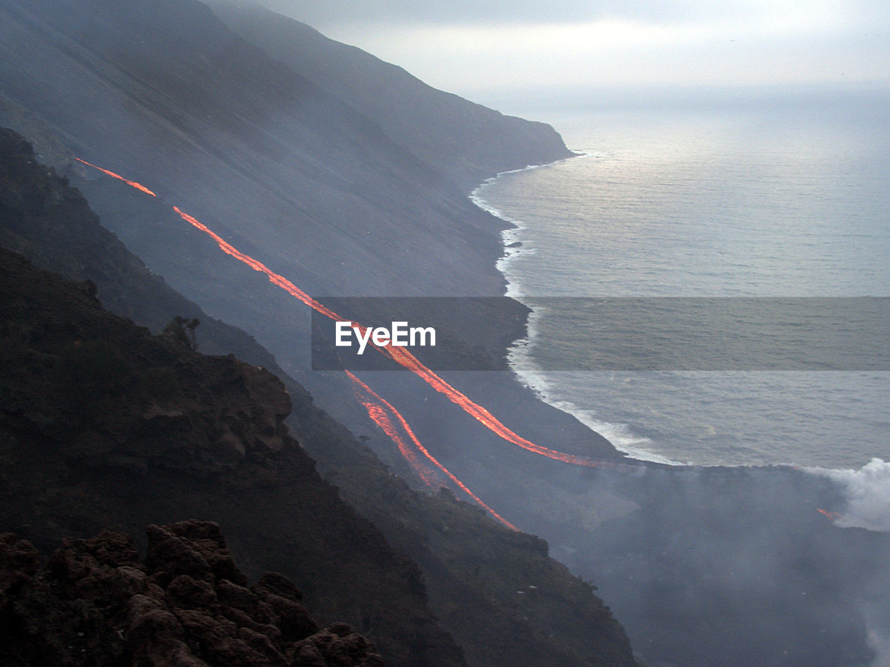 High angle view of stromboli volcano by sea