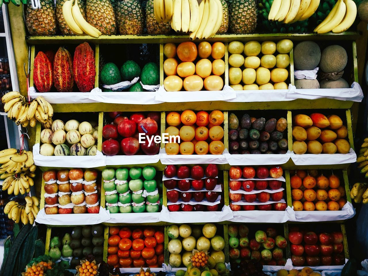HIGH ANGLE VIEW OF VARIOUS FRUITS FOR SALE IN MARKET