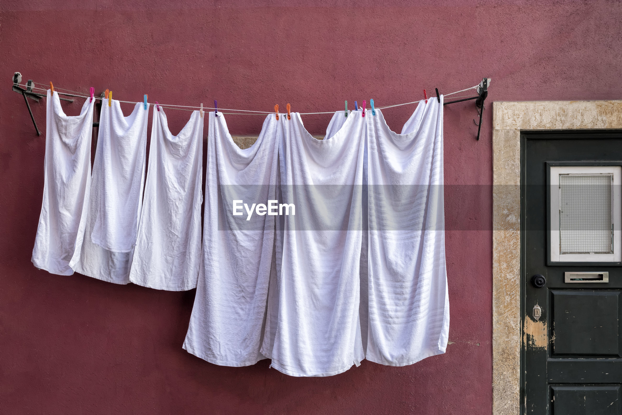 Close-up of clothes drying against wall