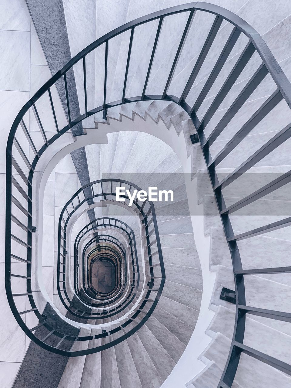 spiral, steps and staircases, spiral staircase, staircase, railing, architecture, built structure, design, indoors, high angle view, diminishing perspective, pattern, shape, directly above, day, no people, white color, repetition, geometric shape, absence, directly below
