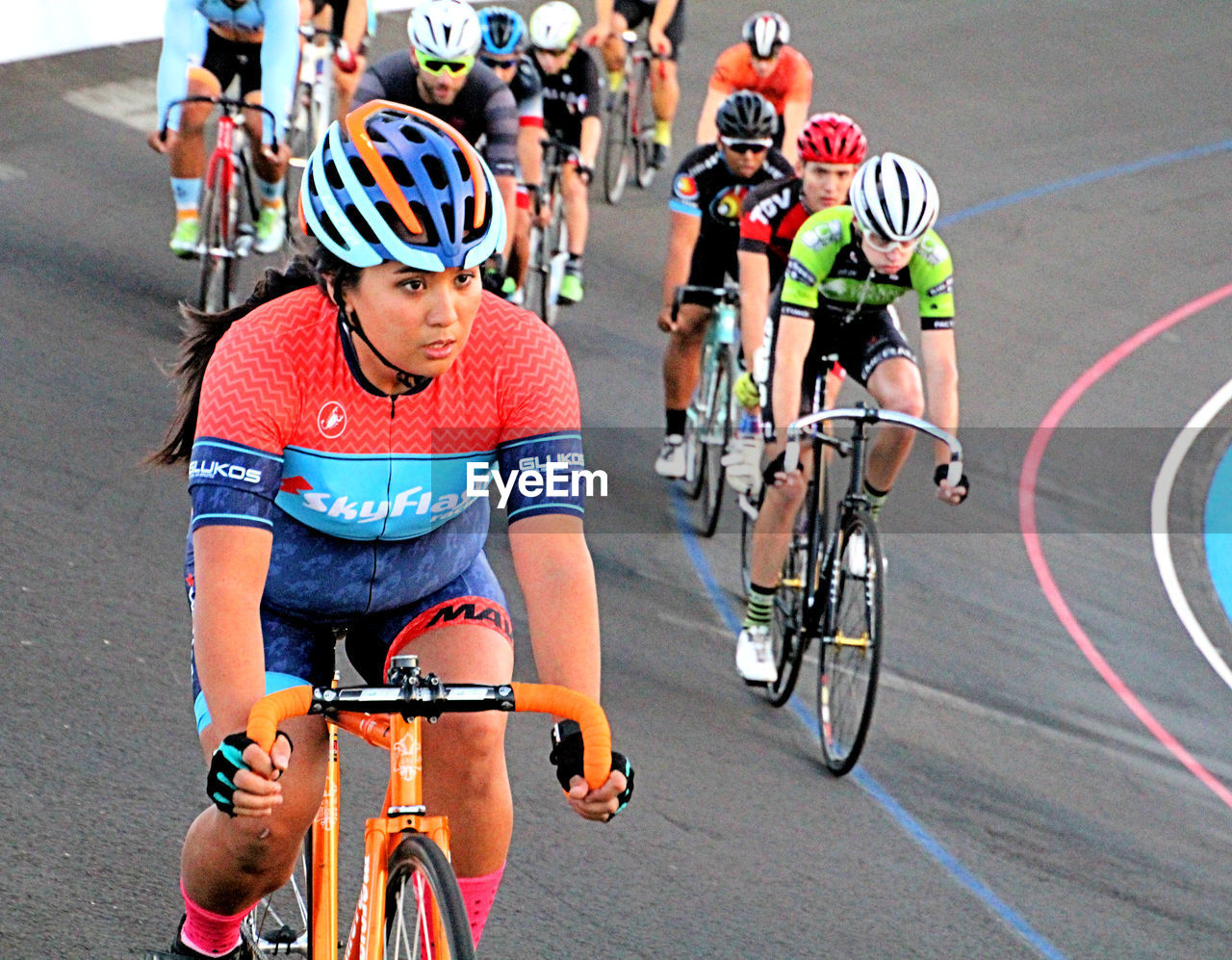 bicycle, competition, sports race, cycling, sport, racing bicycle, sports clothing, sports track, exercising, men, riding, competitive sport, headwear, outdoors, athlete, track and field event, sports event, endurance, healthy lifestyle, adult, sportsman, track and field athlete, day, cycling helmet, adults only, triathlon, people