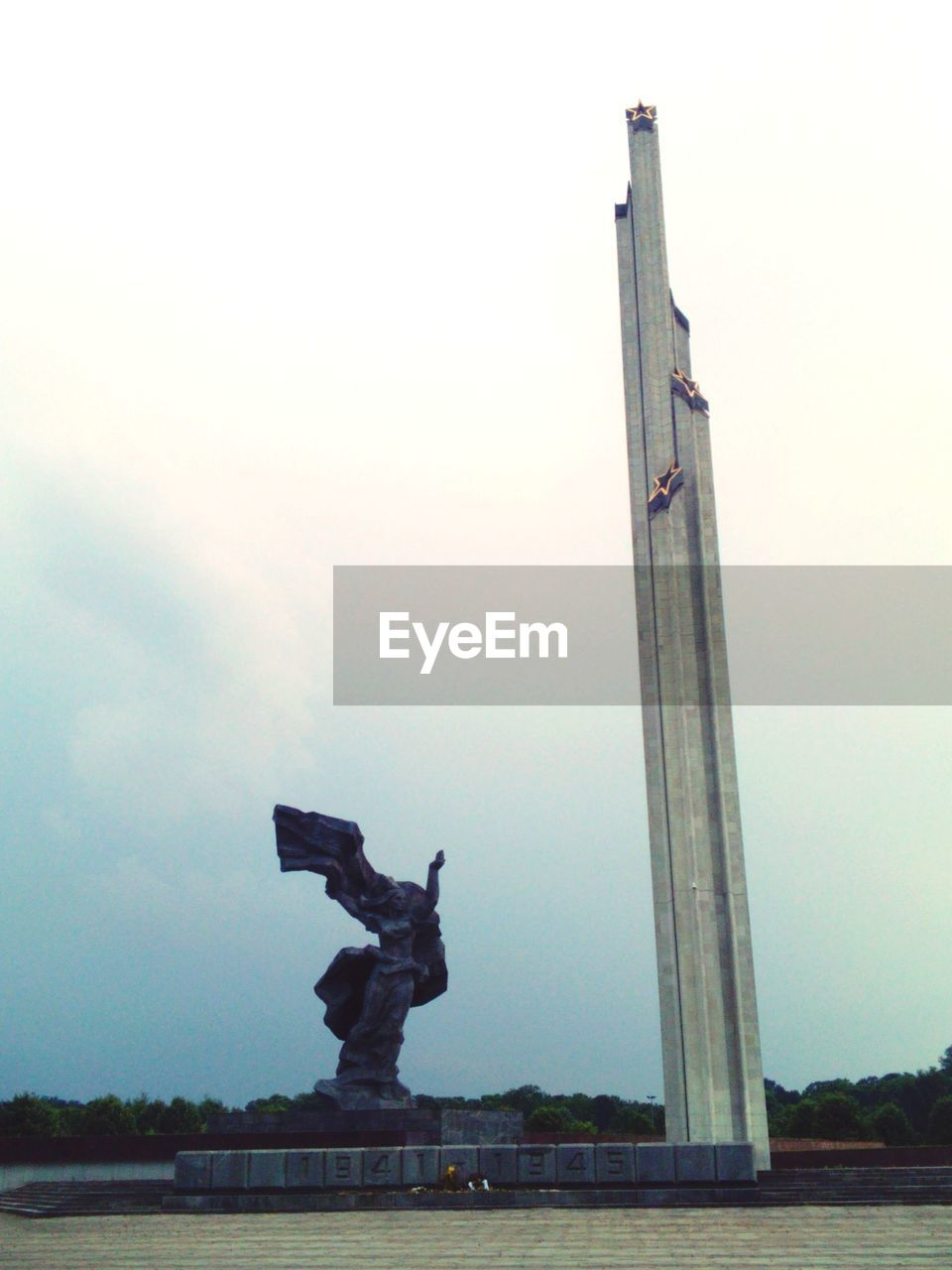 sculpture, statue, human representation, sky, outdoors, day, low angle view, built structure, no people, architecture, water, nature