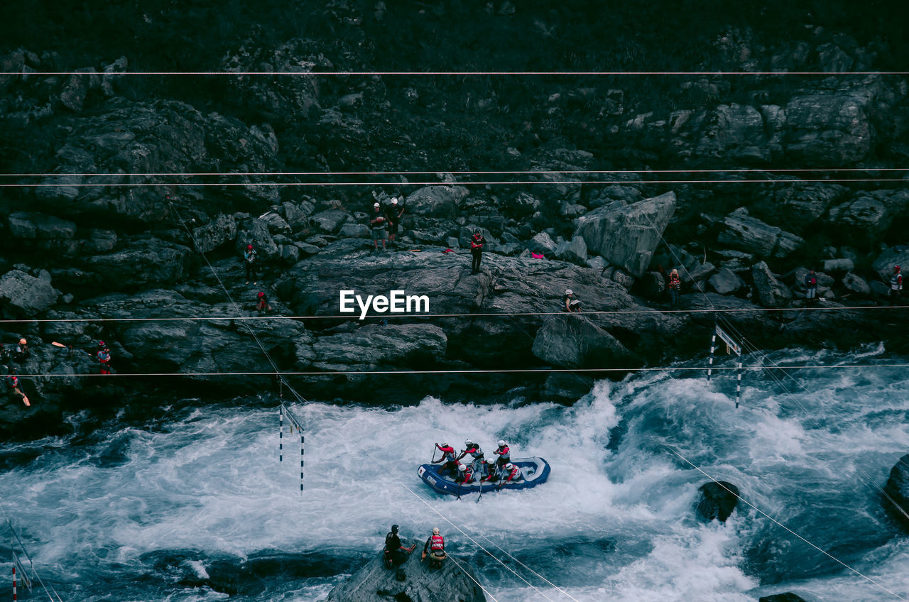 High angle view of people rafting on river