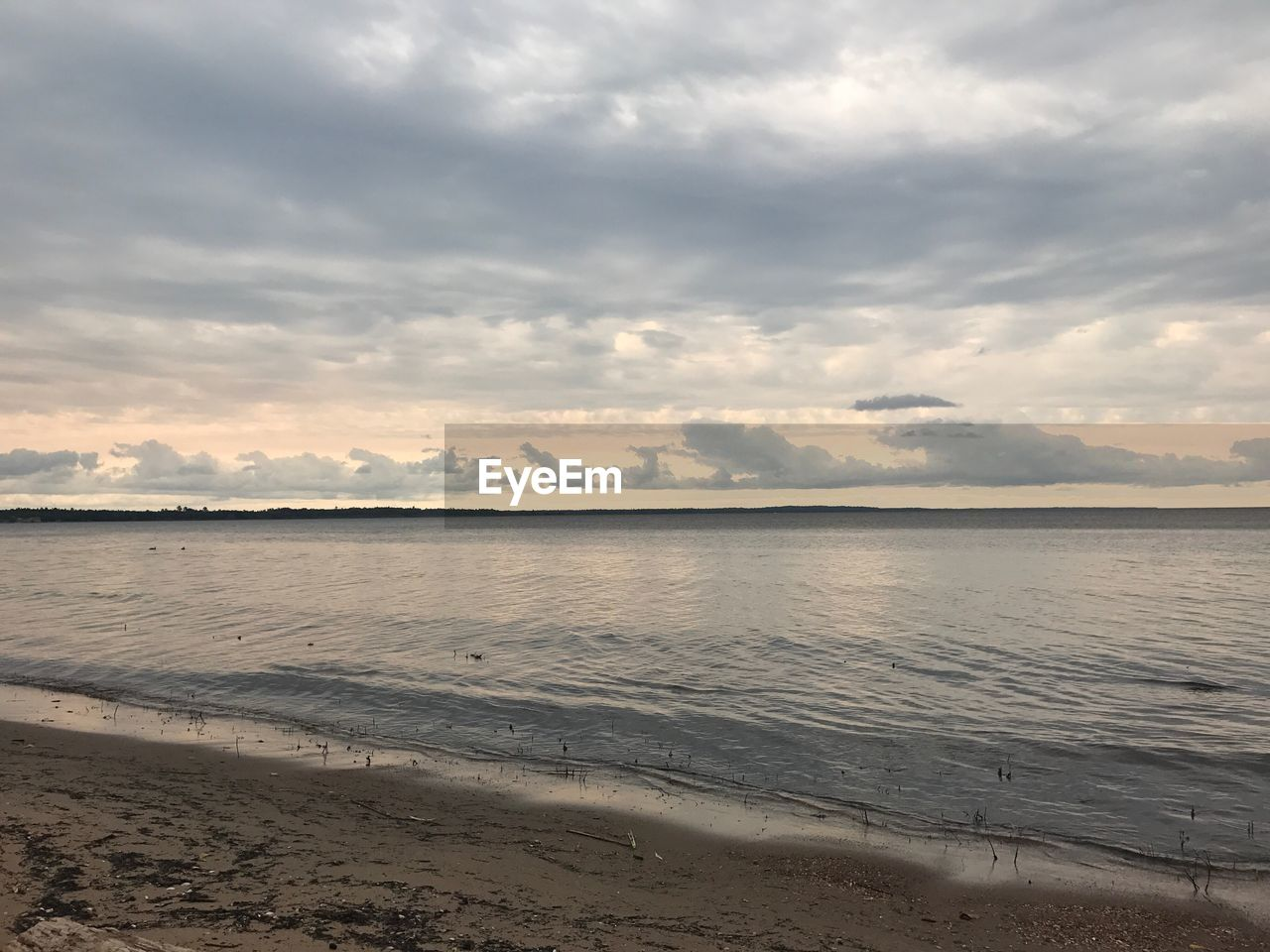 water, beach, sky, nature, tranquility, sea, beauty in nature, cloud - sky, tranquil scene, scenics, sand, no people, outdoors, sunset, horizon over water, day