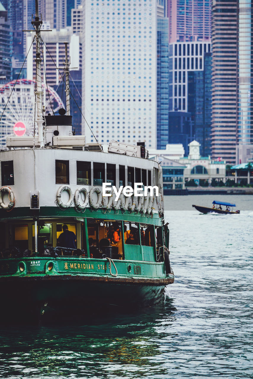 nautical vessel, transportation, water, mode of transportation, built structure, building exterior, city, architecture, waterfront, travel, building, day, river, passenger craft, ship, ferry, sailing, craft, no people, office building exterior, luxury, yacht, cruise ship, skyscraper