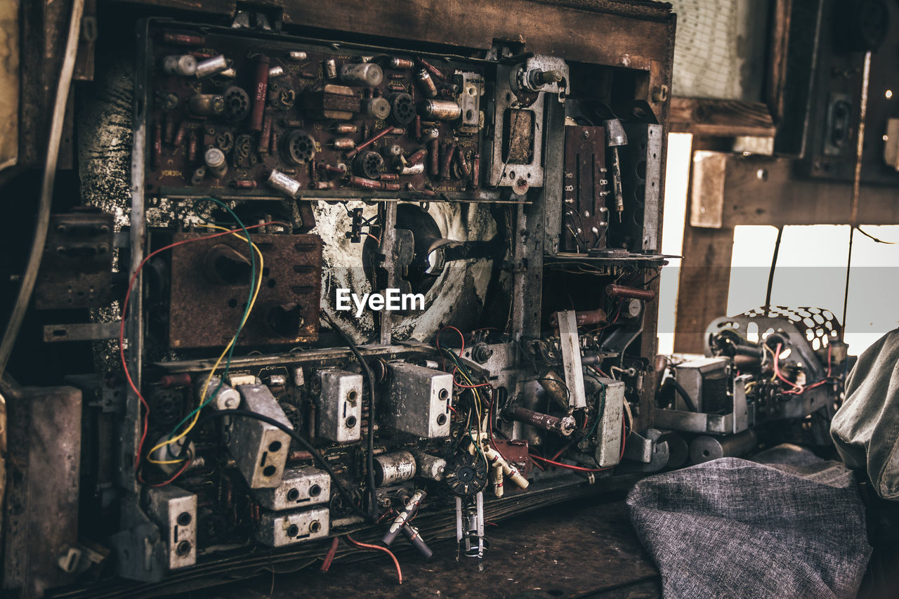 machinery, indoors, old, machine part, abandoned, no people, technology, equipment, metal, obsolete, control, industry, damaged, work tool, factory, workshop, architecture, valve, deterioration, complexity, manufacturing equipment, machine valve, industrial equipment