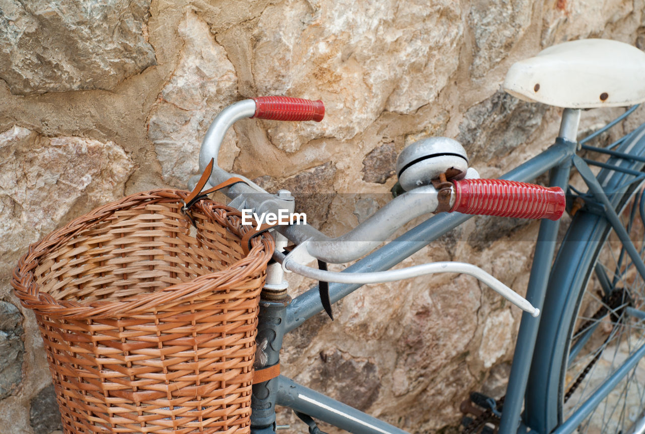 High angle view of bicycle leaning on stone wall