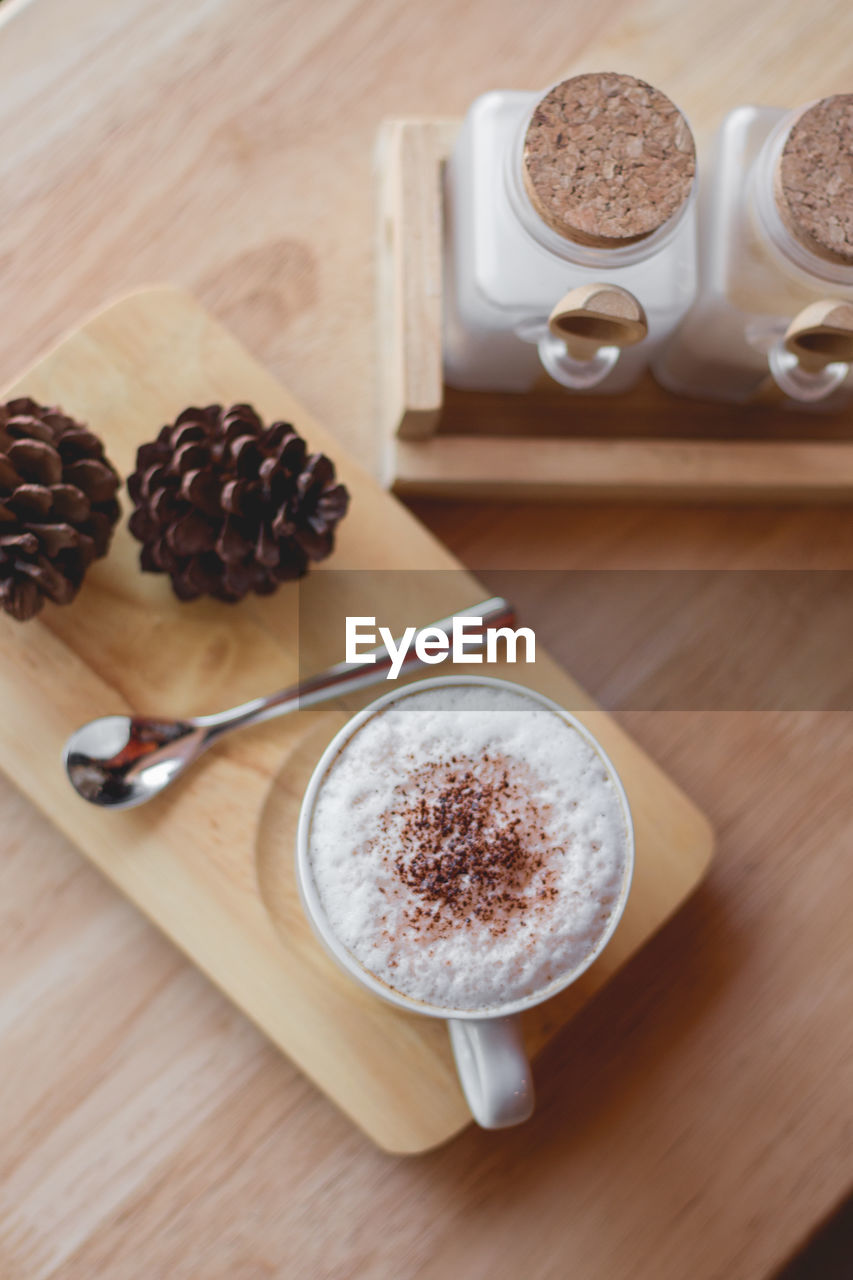 food and drink, table, drink, still life, food, refreshment, freshness, coffee, spoon, eating utensil, kitchen utensil, indoors, cup, coffee - drink, mug, no people, coffee cup, wood - material, high angle view, cappuccino, hot drink, frothy drink, latte, crockery, froth, breakfast