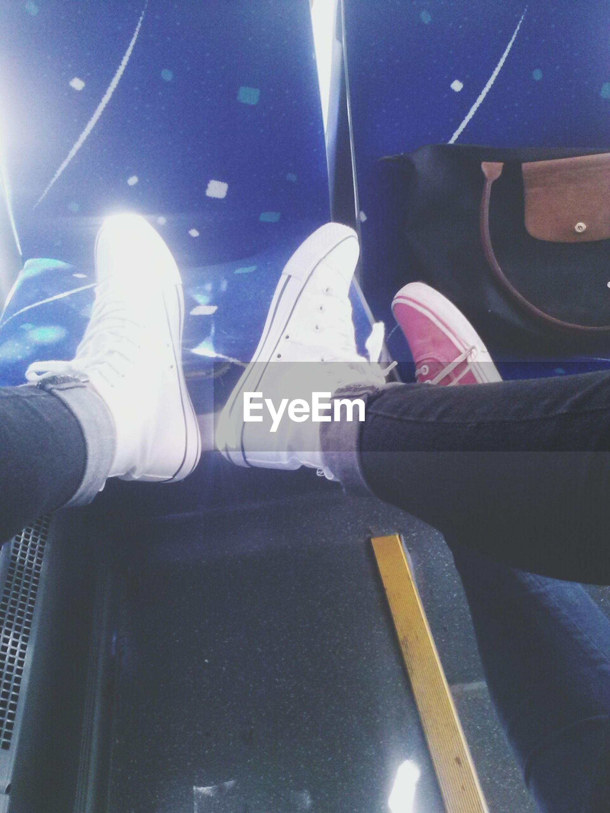 low section, person, lifestyles, part of, personal perspective, men, shoe, leisure activity, human foot, unrecognizable person, indoors, night, transportation, vehicle interior, footwear, close-up, sunlight