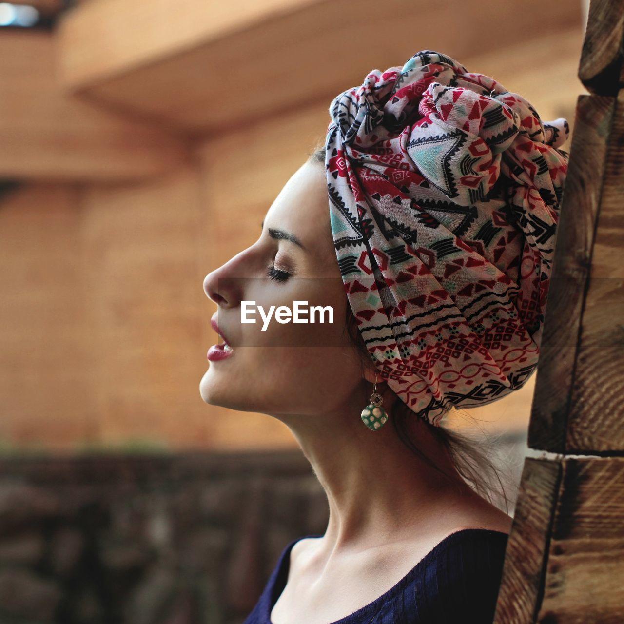 Profile View Of Beautiful Woman Wearing Headscarf