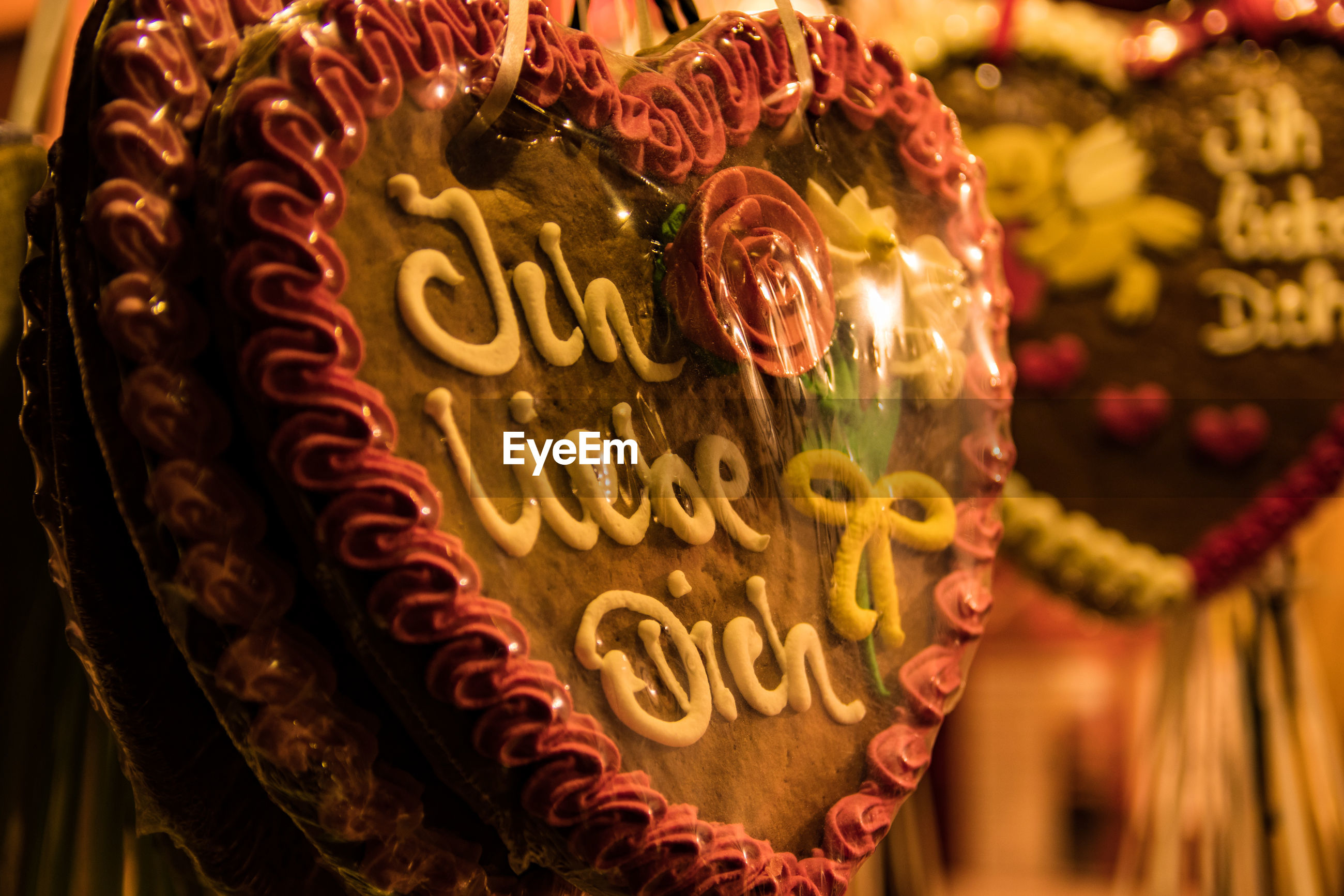 Close-up of gingerbread cookies for sale at market during night
