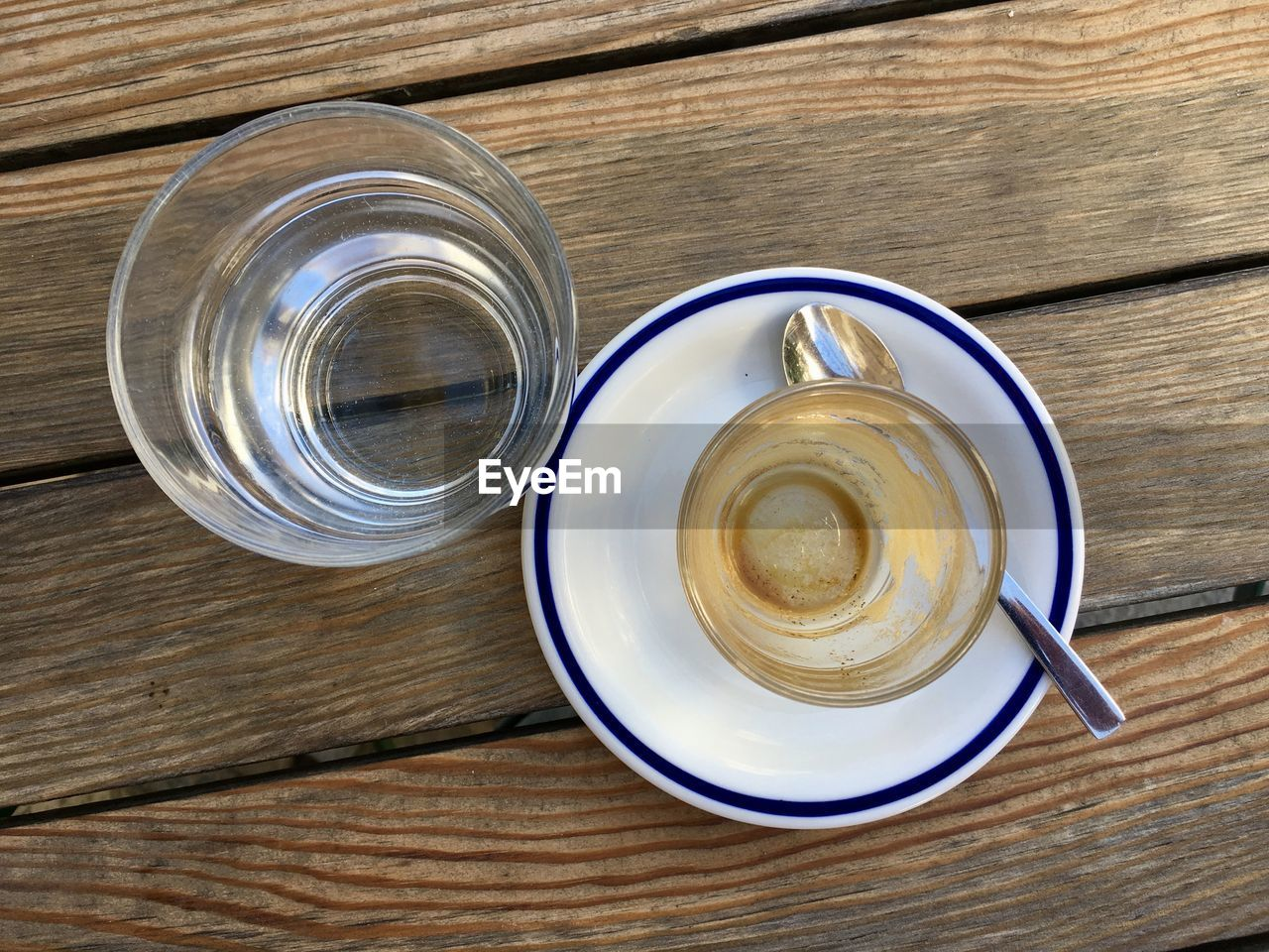 High Angle View Of Coffee And Water Glass On Table