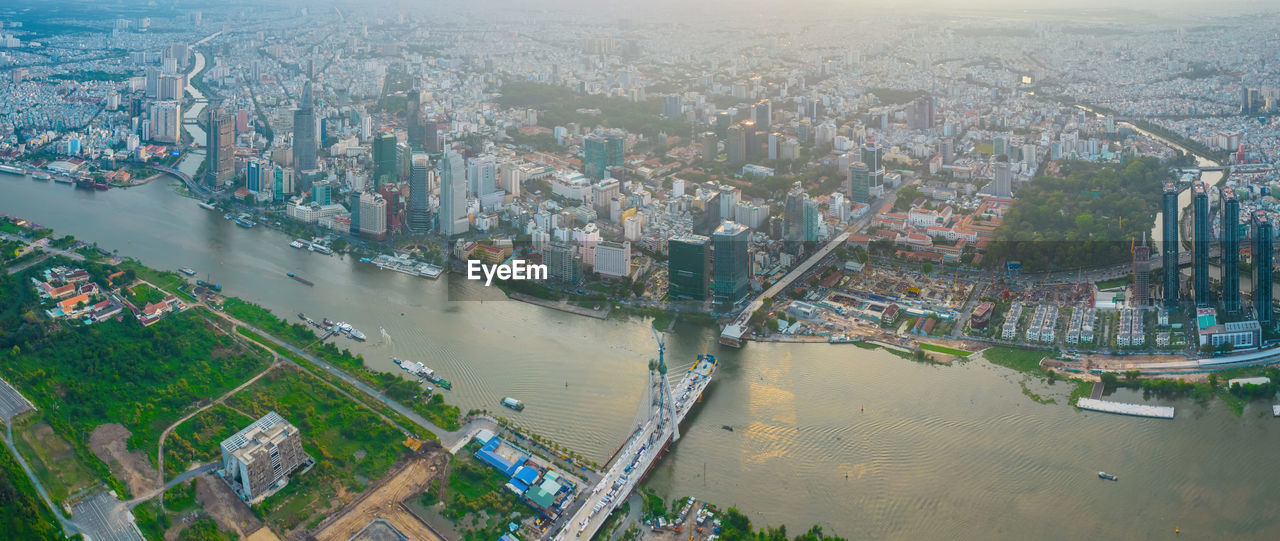 HIGH ANGLE VIEW OF RIVER AMIDST BUILDINGS
