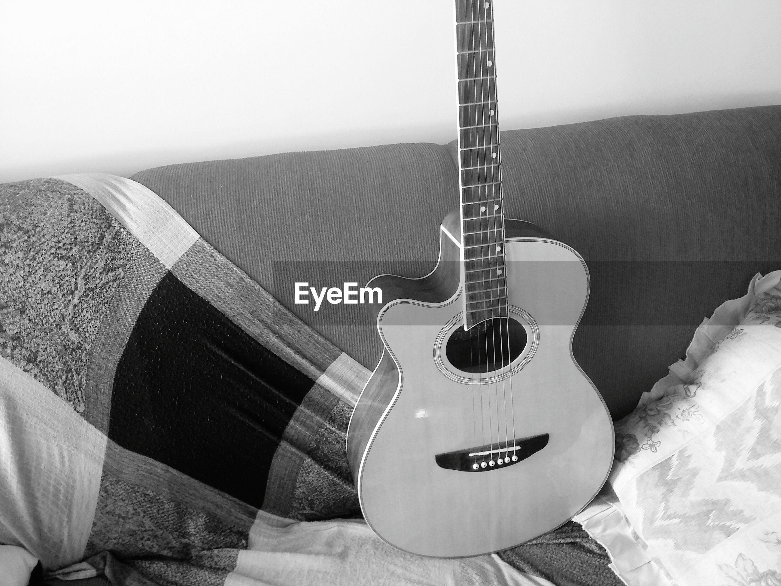 musical instrument, technology, guitar, music, arts culture and entertainment, communication, indoors, metal, musical equipment, no people, musical instrument string, close-up, high angle view, day, equipment, still life, old-fashioned, hanging, protection, part of