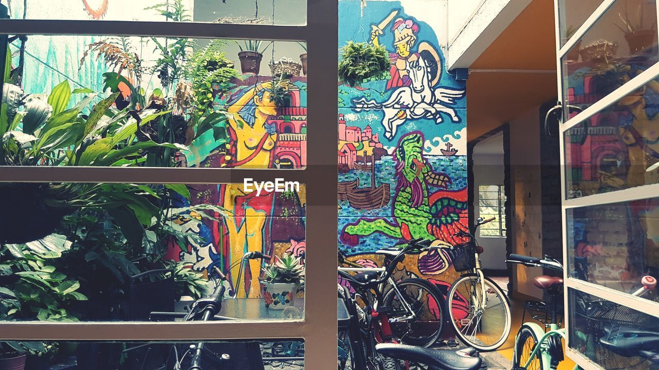 multi colored, graffiti, art and craft, creativity, no people, day, choice, architecture, built structure, outdoors, variation, human representation, retail, representation, transportation, nature, wall - building feature, store, mural