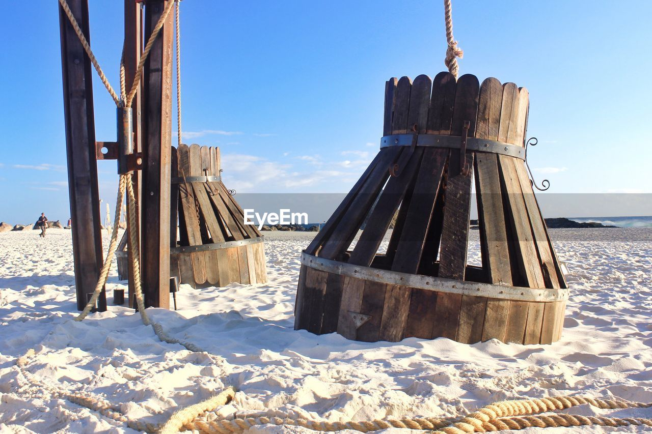 Wooden Structures At Beach Against Sky