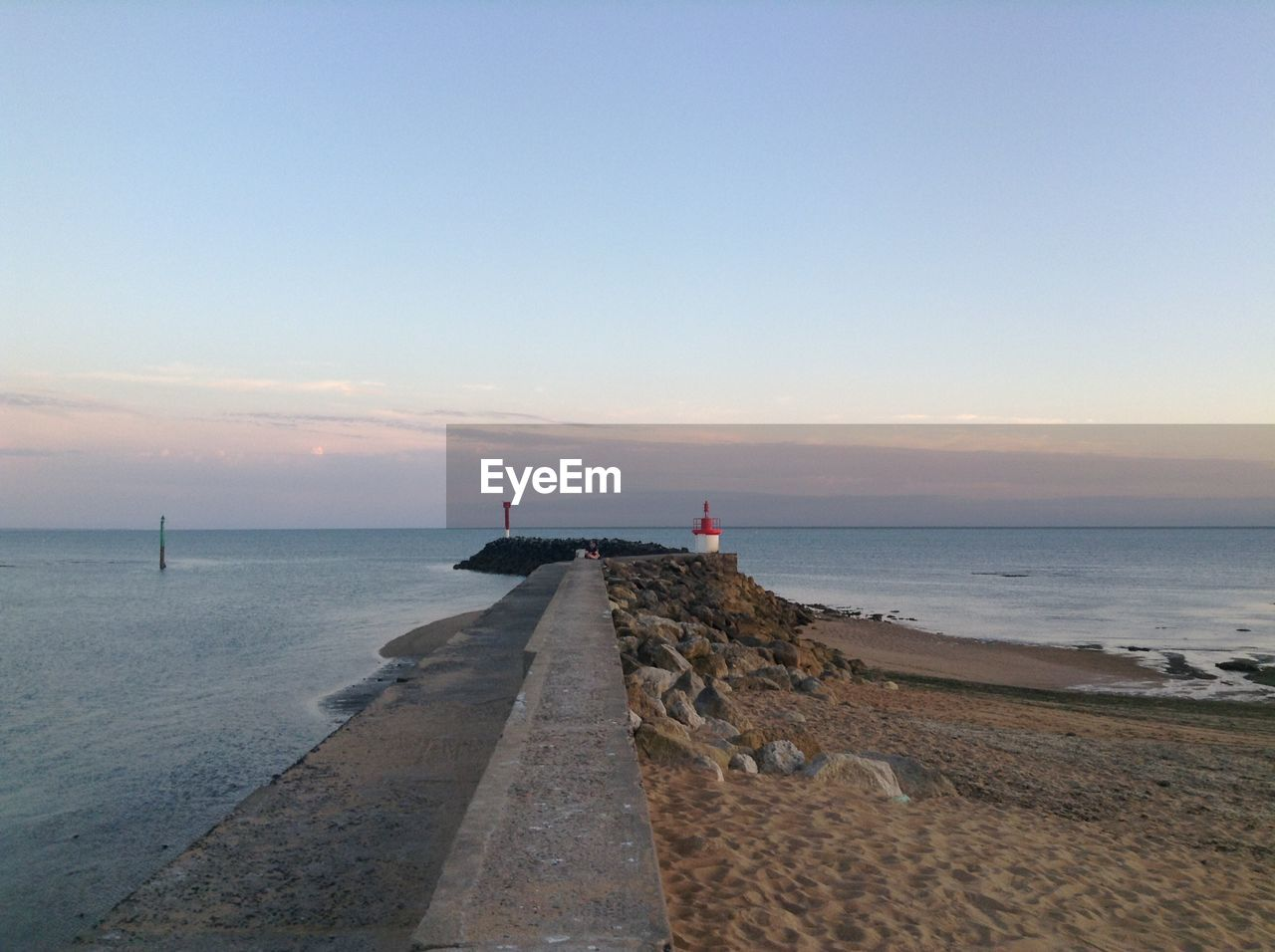 Scenic view of pier at sea against sky during sunset