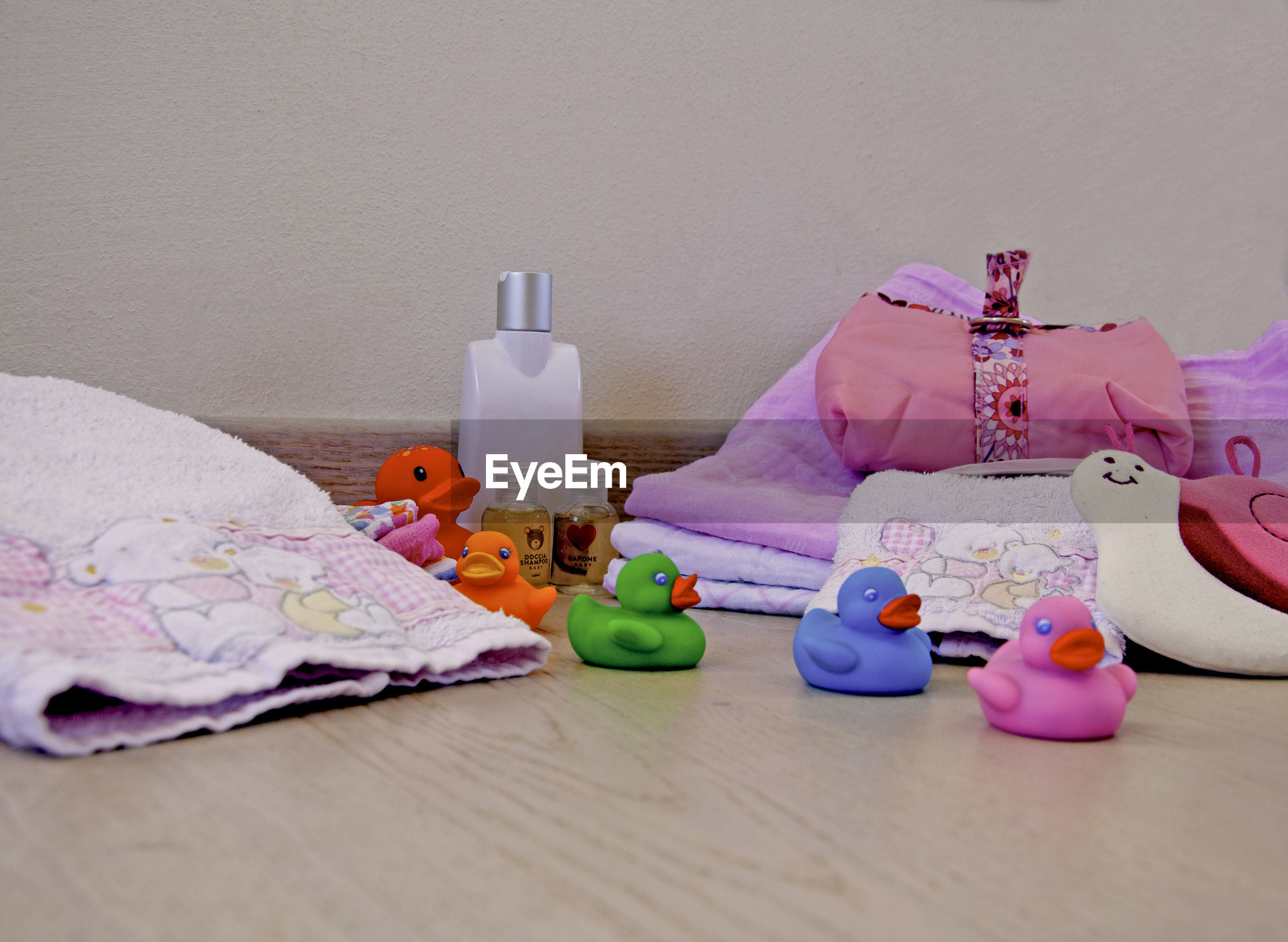 CLOSE-UP OF MULTI COLORED TOYS ON TABLE