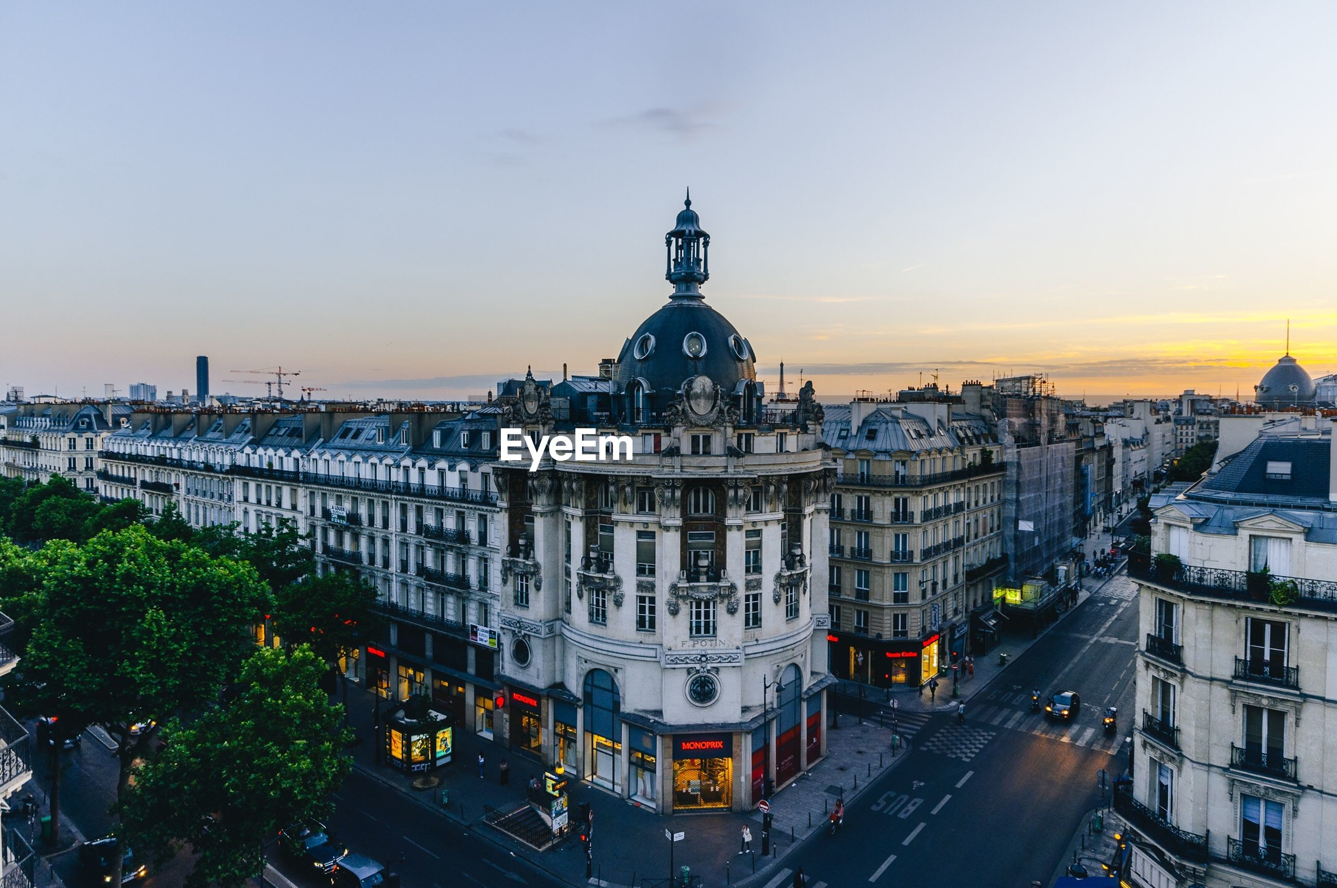architecture, building exterior, built structure, city, high angle view, sunset, cityscape, transportation, outdoors, sky, travel destinations, city life, dome, clock tower, no people, day