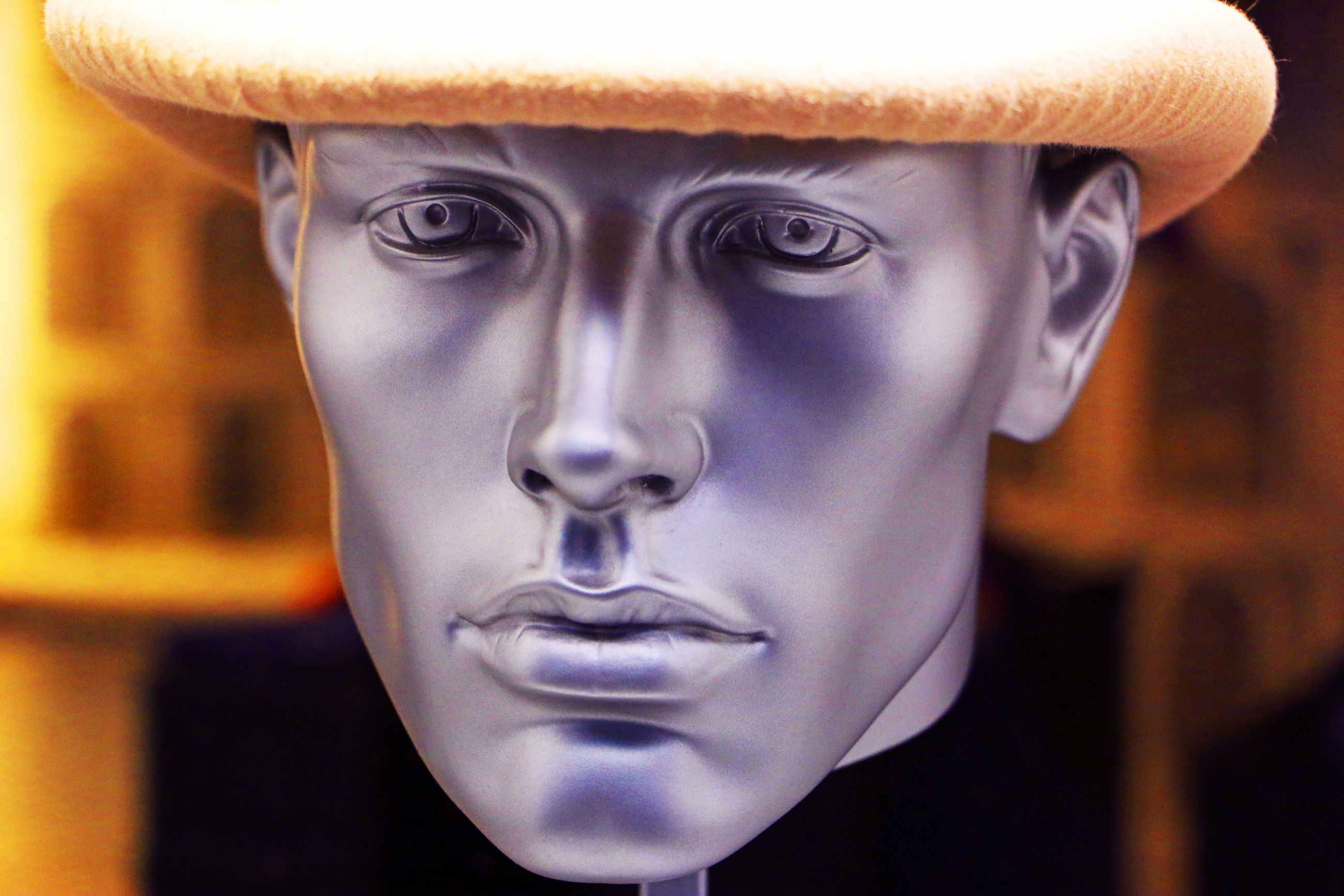 CLOSE-UP PORTRAIT OF STATUE AGAINST BLURRED BACKGROUND