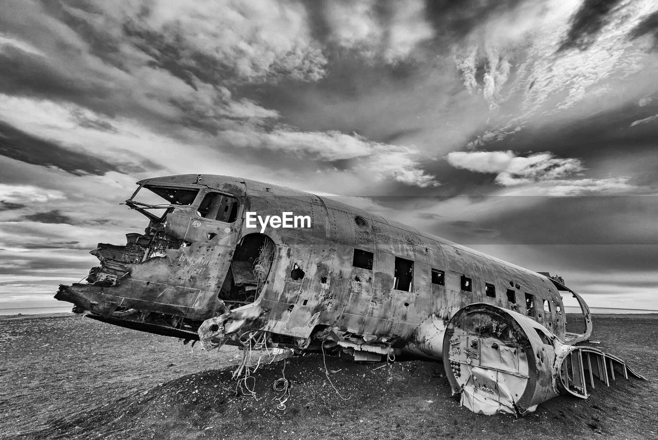 Abandoned Airplane At Beach Against Sky