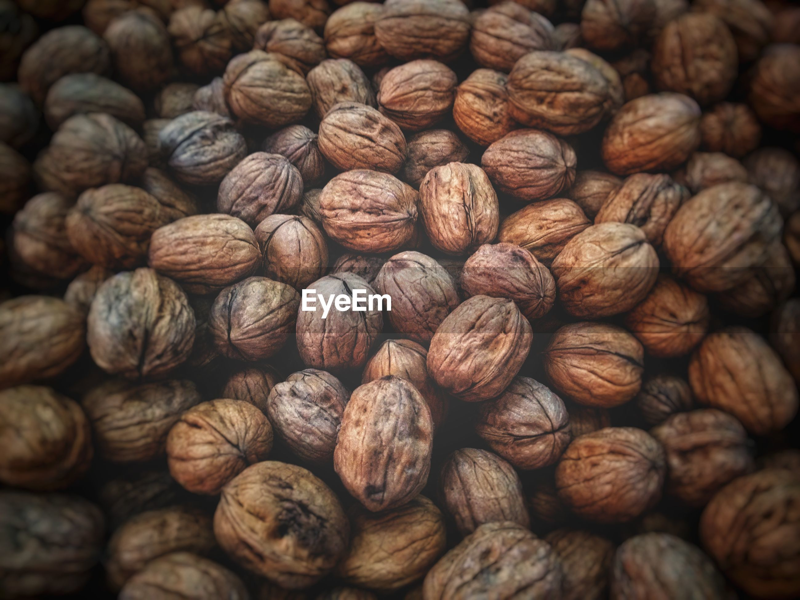 Full frame shot of walnuts for sale at market