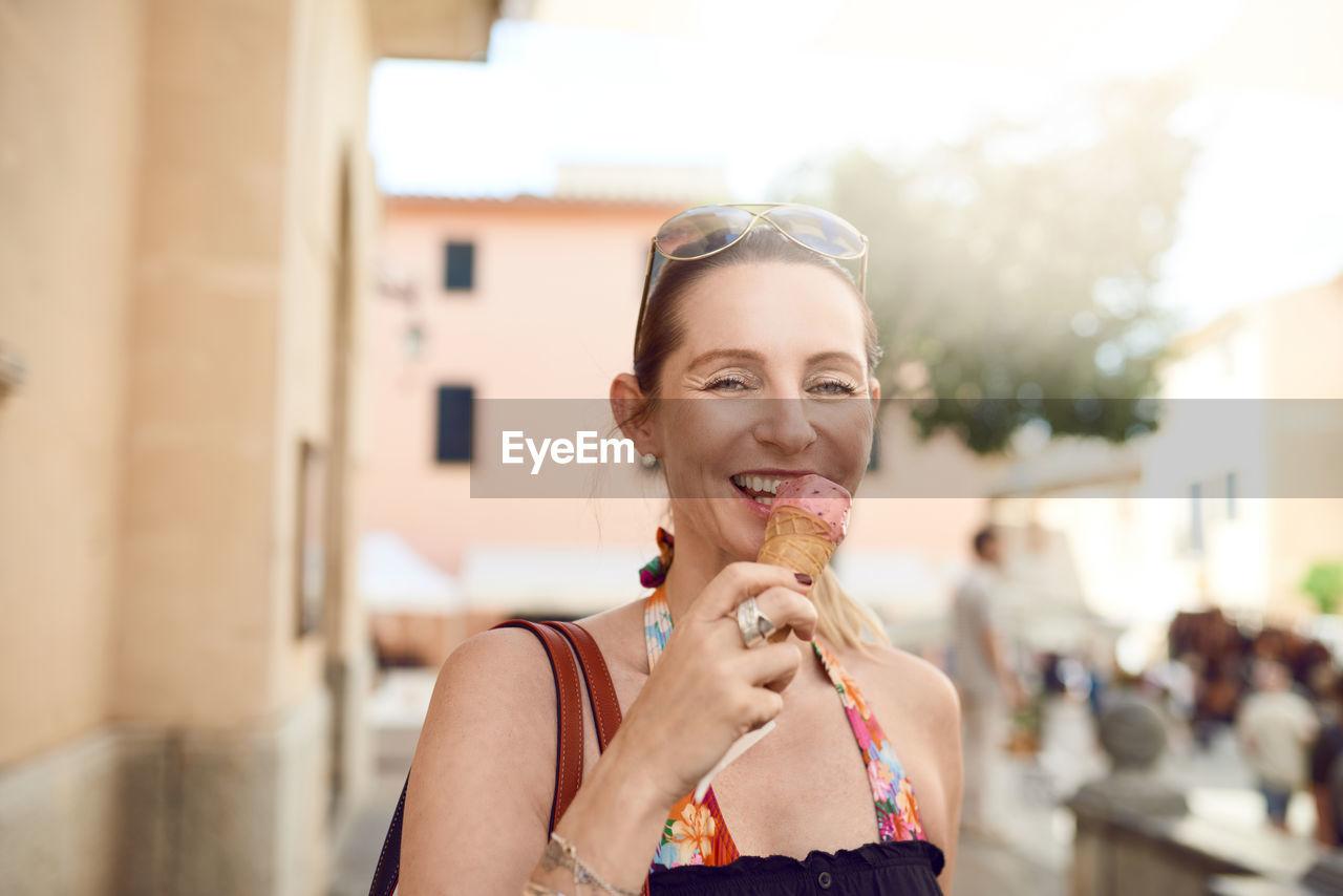 Portrait Of Mature Woman Eating Ice Cream
