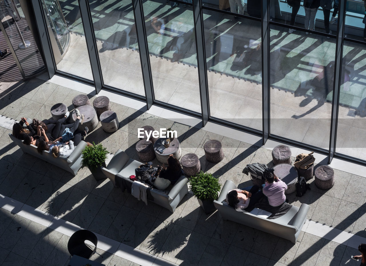 High Angle View Of People Sitting At Window