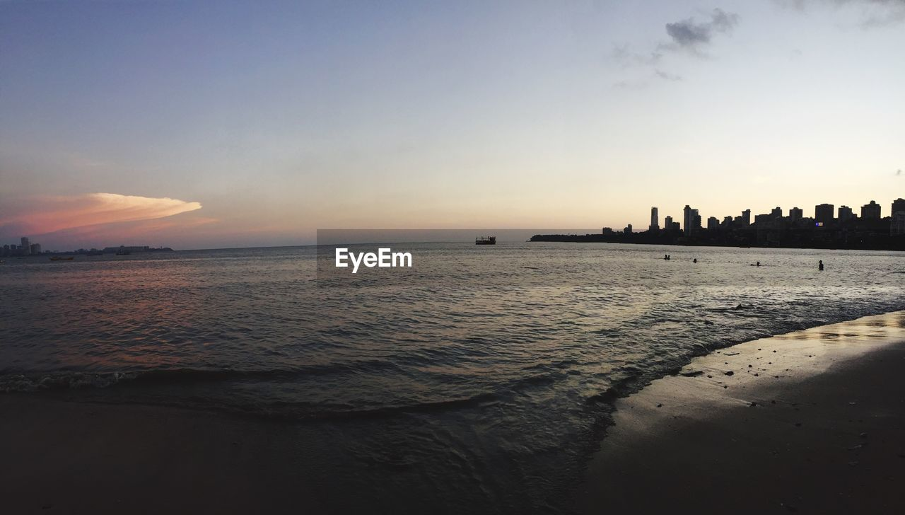 water, sea, sky, sunset, scenics - nature, beach, beauty in nature, land, nature, tranquility, horizon, tranquil scene, horizon over water, architecture, built structure, building exterior, idyllic, cloud - sky, waterfront, no people, outdoors