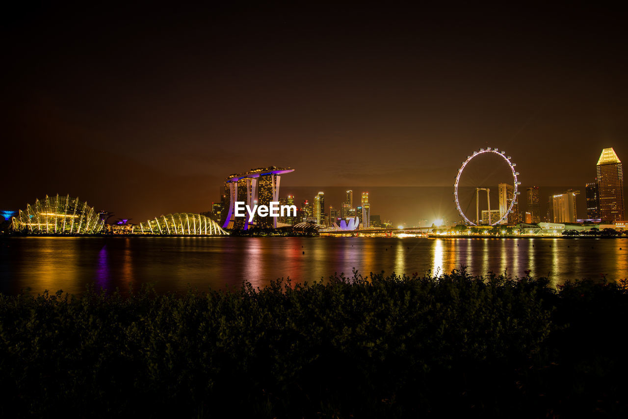 night, architecture, built structure, illuminated, water, sky, building exterior, river, city, nature, no people, travel destinations, reflection, waterfront, bridge, bridge - man made structure, outdoors, transportation, office building exterior, skyscraper, bay