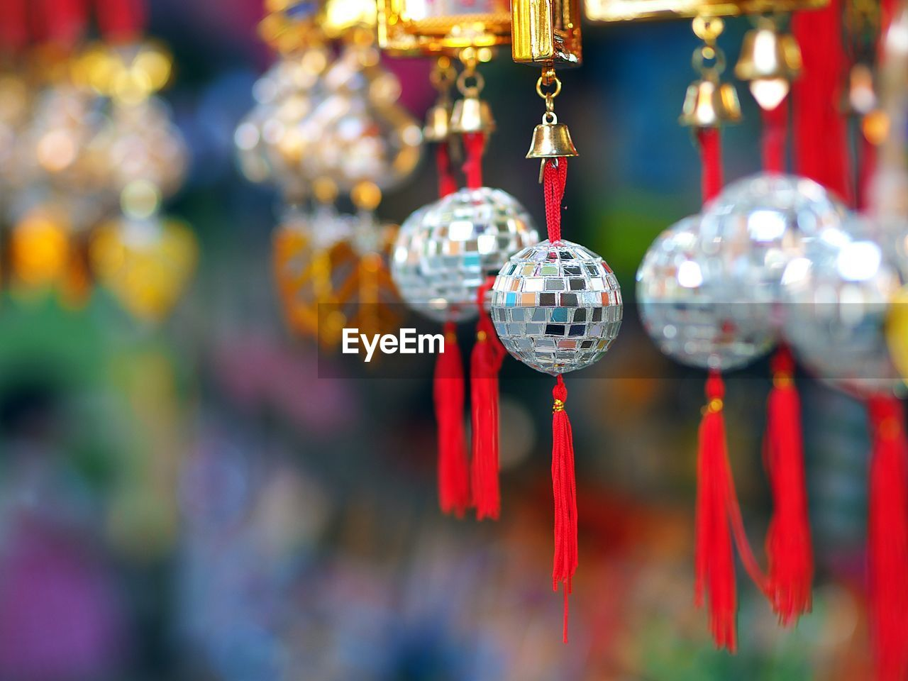 hanging, decoration, focus on foreground, close-up, for sale, market, red, retail, no people, selective focus, art and craft, creativity, craft, lighting equipment, choice, retail display, day, design, outdoors, shape, christmas ornament, consumerism, silver colored