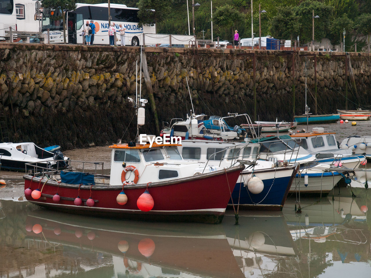 nautical vessel, moored, transportation, water, mode of transportation, harbor, waterfront, nature, reflection, no people, day, lake, outdoors, pier, sailboat, pole, port, fishing industry, fishing boat, marina, anchored, yacht