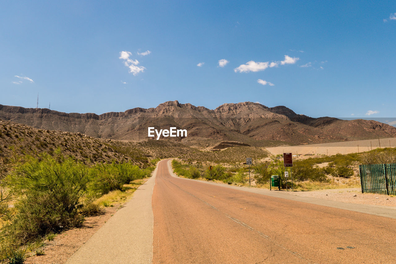 the way forward, road, sky, direction, transportation, mountain, scenics - nature, landscape, nature, diminishing perspective, non-urban scene, tranquil scene, no people, day, environment, beauty in nature, tranquility, empty road, cloud - sky, desert, mountain range, outdoors, arid climate, long