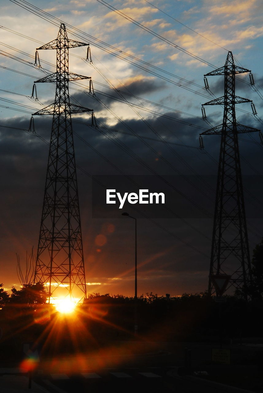 sunset, sky, cloud - sky, electricity, electricity pylon, technology, power line, connection, power supply, silhouette, cable, orange color, fuel and power generation, low angle view, no people, nature, sun, metal, field, outdoors, complexity, electrical equipment