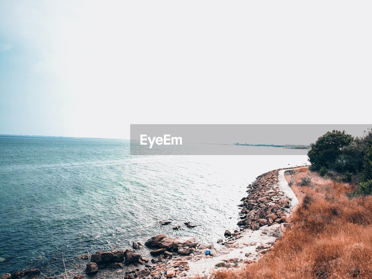 sea, water, sky, horizon, horizon over water, scenics - nature, beauty in nature, clear sky, day, nature, copy space, tranquility, tranquil scene, beach, land, rock, no people, idyllic, outdoors