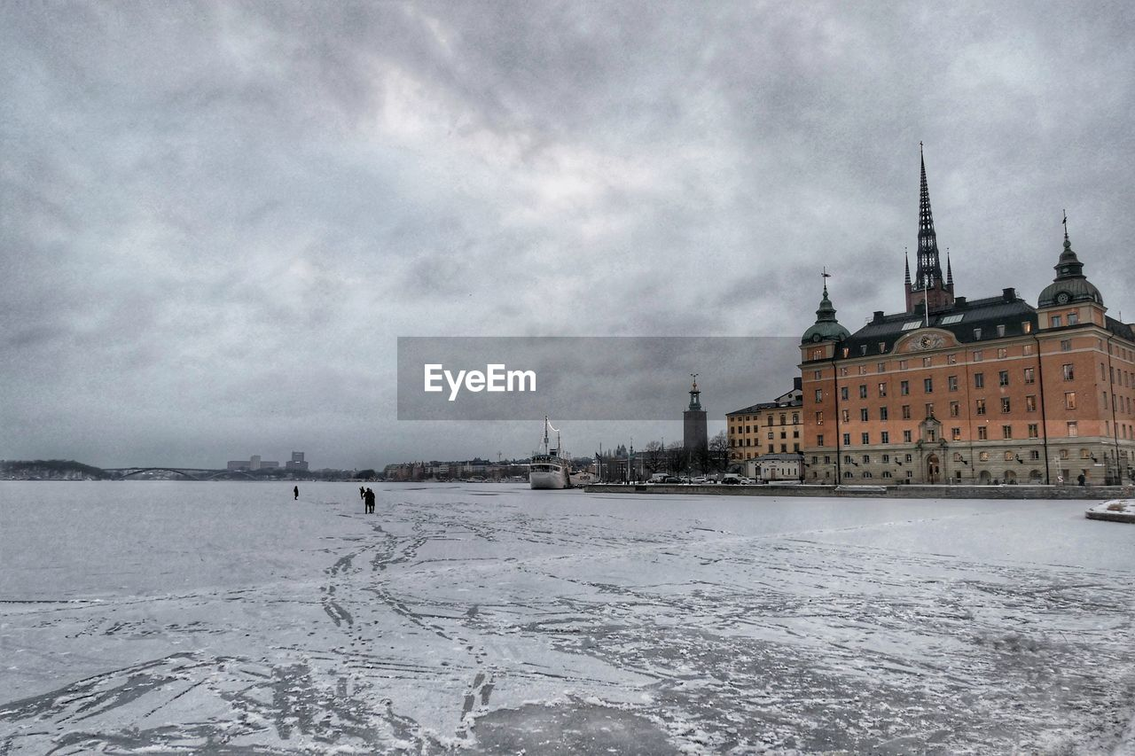 architecture, sky, built structure, building exterior, cloud - sky, cold temperature, winter, nature, water, building, snow, travel destinations, no people, day, city, frozen, religion, outdoors, ice, spire