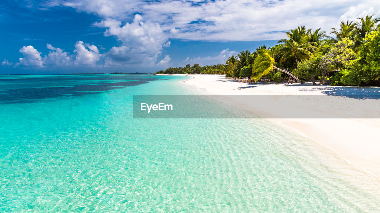 water, sea, sky, beauty in nature, scenics - nature, beach, land, tranquility, tranquil scene, cloud - sky, tropical climate, tree, idyllic, nature, day, sand, no people, turquoise colored, blue, outdoors, horizon over water