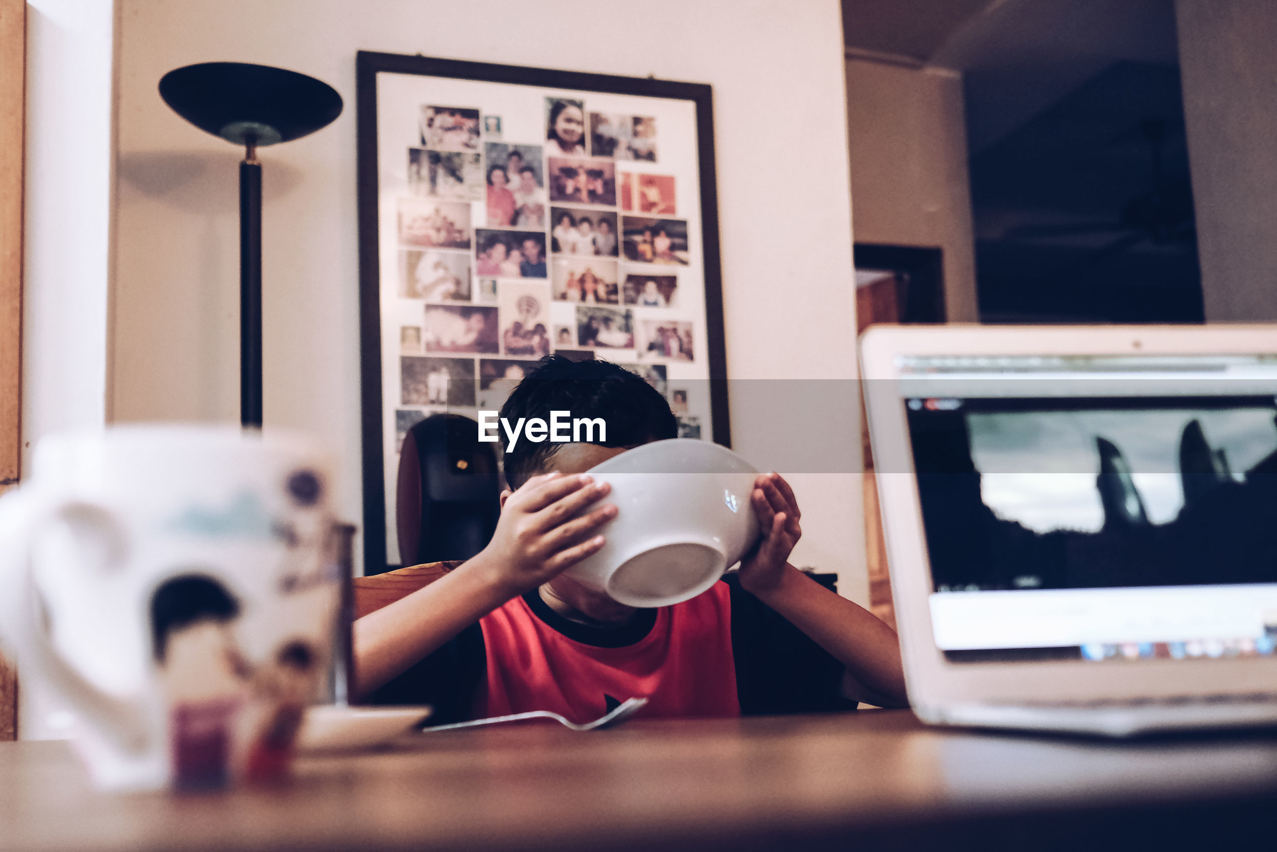Low angle view of boy eating food at table